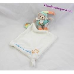 Doudou lapin marionnette plat bleu tatoo fleurs Doudou et Compagnie