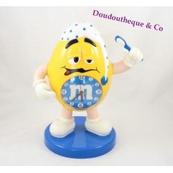 Réveil M&M's jaune sur fond bleu brosse à dents horloge publicitaire