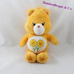 Peluche ours Groscopain CARE BEARS Bisounours orange clair fleurs 23 cm