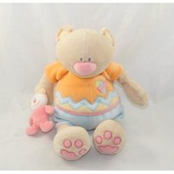 Doudou musical Teddy bear NATTOU wheelbarrow orange shorts blue 25 cm